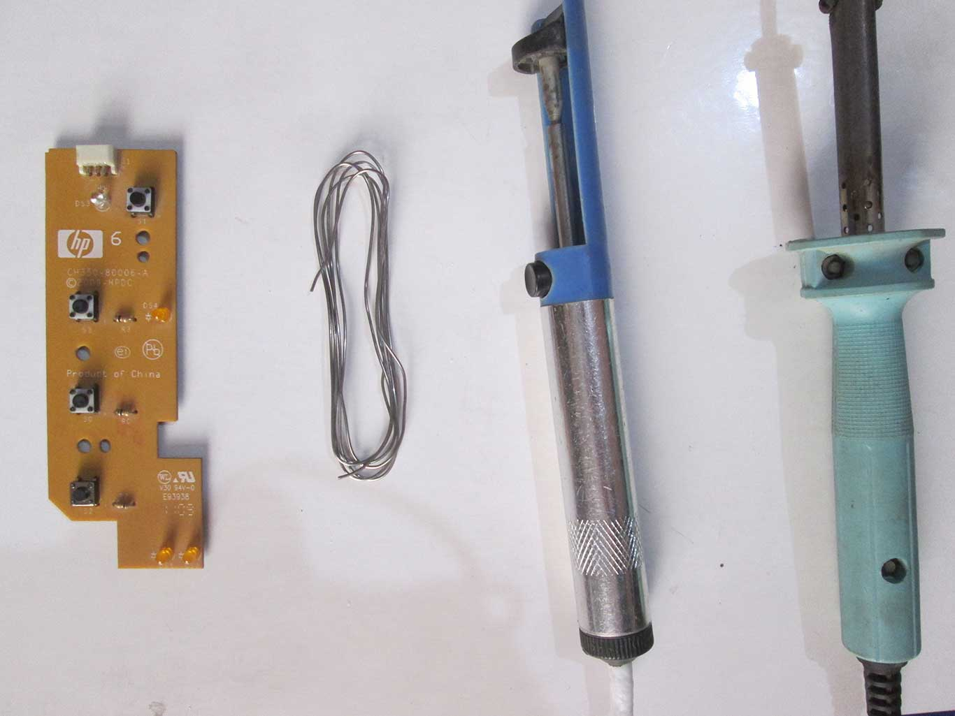 Tools used to solder the push button on the circuit board